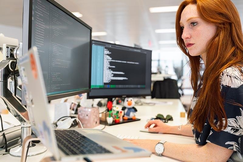 A Woman Sets Up a CGI Rendering Algorithm