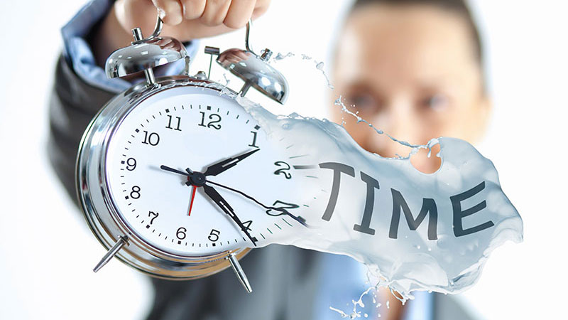 A 3D Rendering Specialist Holding a Clock in Her Hands