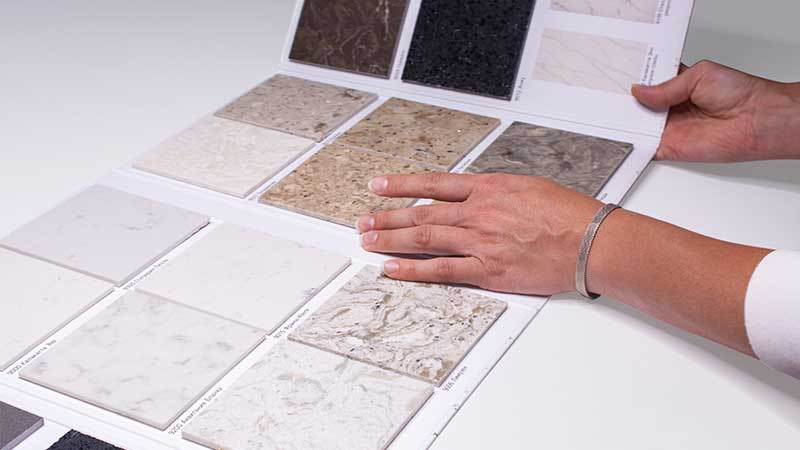 A Woman Selecting Furniture Materials for a CG Rendering Brief