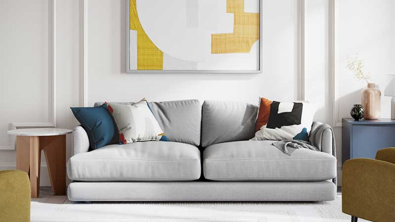 A 3D Image of Grey Couch within a Lifestyle Scene