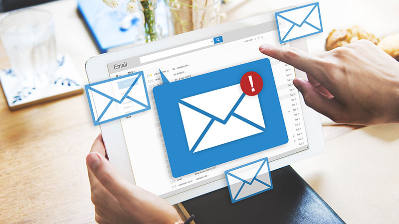 A Person Using Innovative Collateral for Email Marketing Strategies