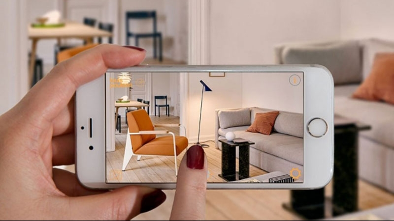 A Person Using AR App Made to Sell Furniture Pieces Online