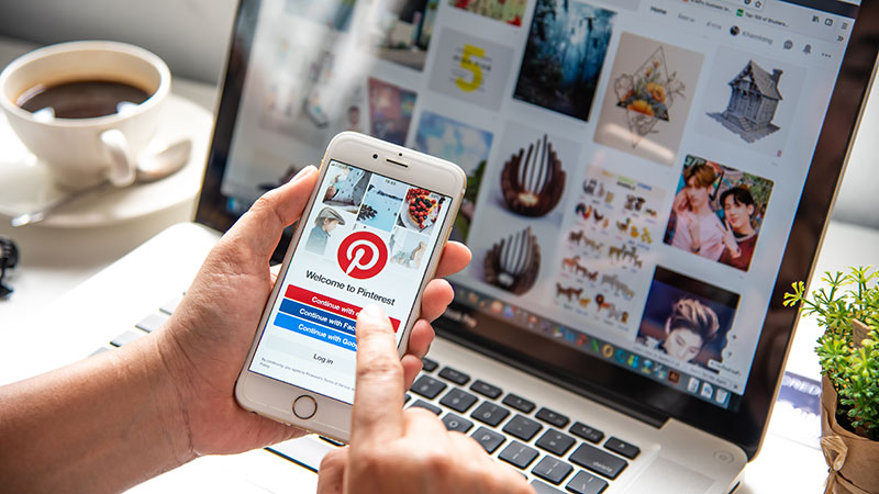 A Person Browsing Pinterest for Inspiration for Furniture Promo and Design Ideas