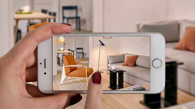 A Woman Using an Ecommerce AR Tool to Add Virtual Furnishing to the Room