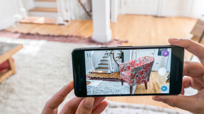 A Customer Trying New Armchair for their Front Room via an Ecommerce AR app