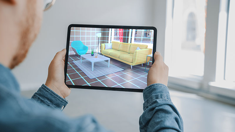 A Man Using Ecommerce Furniture AR App to Find the Best Pieces for a Living Room