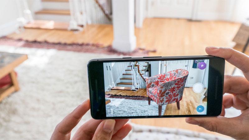 A Customer Choosing an Armchair for Their House Using 3D Augmented Furniture Application