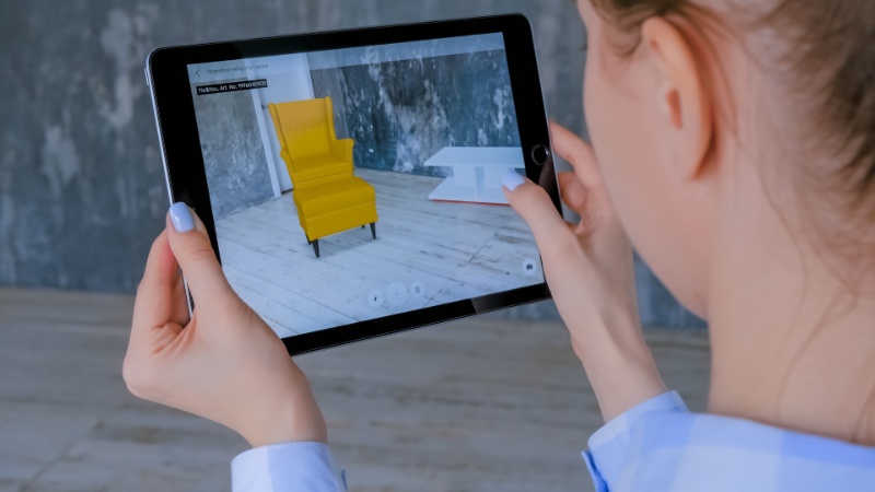 A Woman Using a 3D Augmented Furniture App on Her Tablet