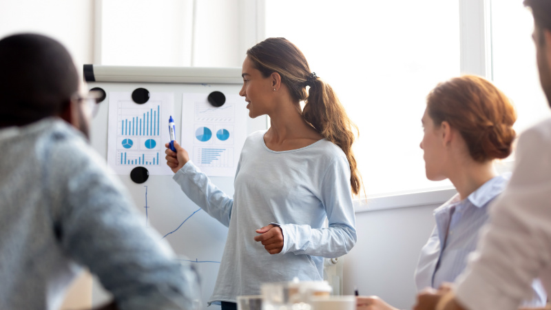 A Marketer Giving the Product Presentation Using Effective Infographic Charts