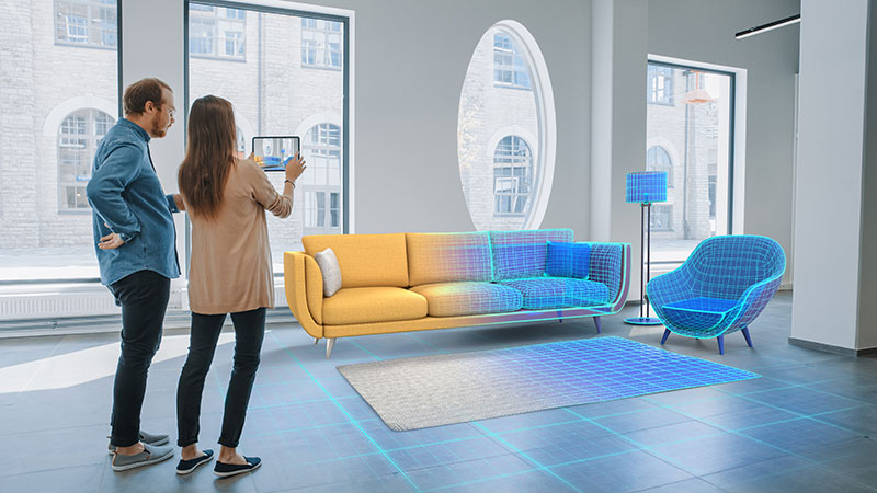 A Young Couple Adding 3D Furniture Models to Their Interior Using an AR App